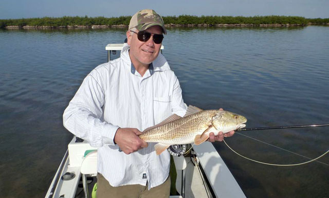 Jerry Siem with redfish