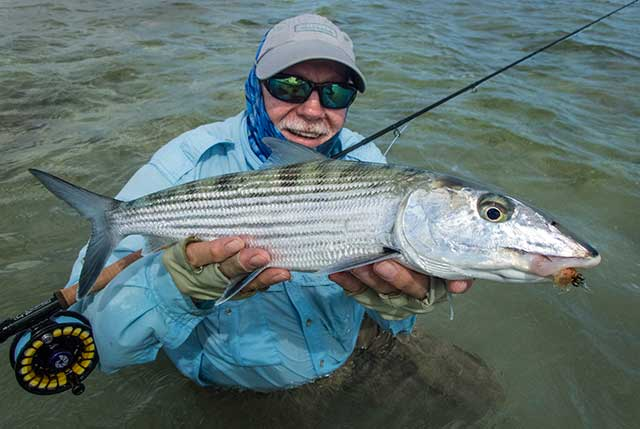 Bill Blanton shows off a 6-pound bonefish caught on the flats of Cayo Paredon, Cuba.